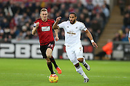 Ashley Williams , the Swansea city captain ® breaks away from Darren Fletcher , the West Bromwich Albion captain (l). Barclays Premier league match, Swansea city v West Bromwich Albion at the Liberty Stadium in Swansea, South Wales  on Boxing Day Saturday 26th December 2015.<br /> pic by  Andrew Orchard, Andrew Orchard sports photography.