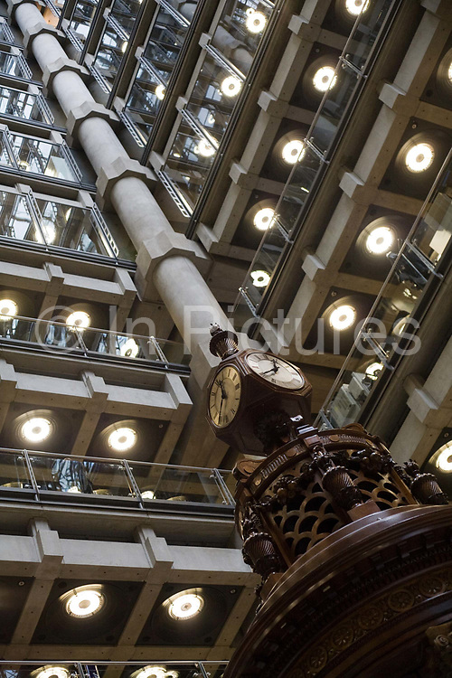 The Lutine Bell in Lloyds of London. The Lutine Bell, weighing 106 pounds and measuring 18 inches in diameter, is traditionally rung to herald important announcements - one stroke for bad news and two for good. The bell was carried on board the French frigate La Lutine (the sprite) which surrendered to the British at Toulon in 1793. Six years later as HMS Lutine and carrying a cargo of gold and silver bullion, she sank off the Dutch coast. The bell was salvaged in 1859 and was hung in Lloyd's Underwriting Room at the Royal Exchange. The modern building was designed by Sir Richard Rogers at Number One Lime Street in a Post-Modernist style. The trading floor at Lloyds is the world's leading insurance market where It serves as a meeting place where multiple financial backers or 'members', whether individuals (traditionally known as 'Names').