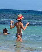 Dave Annable and Odette Yustman..Odette Yustman brings beer to husband Dave Annable while swimming..Celebrities on the Beach while attending the Labor Day weekend in Puerto Rico for Hollywood Domino Celebrity Golf Tournament..Palomino Island, Puerto Rico, USA..Saturday, September 03, 2011..Photo By CelebrityVibe.com..To license this image please call (323) 325-4035; or .Email: CelebrityVibe@gmail.com ; .website: www.CelebrityVibe.com.**EXCLUSIVE**