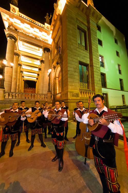 An estudiantina (strolling minstrel group) performing in the narrow windy streets of Guanajuato (Teatro Juarez in background), Mexico