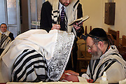 The grandfather of the baby boy assist the Mohel in holding the boy while the father of the boy reads a prayer before giving the Mohel the blade. On the 8th day after birth a Brit Milah (Circumcision) is performed on a Jewish baby boy (unless there is a medical reason to delay it). The ceremony takes place in the synagogue and the man who carries out the skin removal is know as a Mohel and is medically trained, the boy is also given his Hebrew and/or English names.