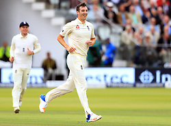 England's Toby Roland-Jones celebrates taking the wicket of West Indies' Jermaine Blackwood during day one of the Third Investec Test match at Lord's, London.