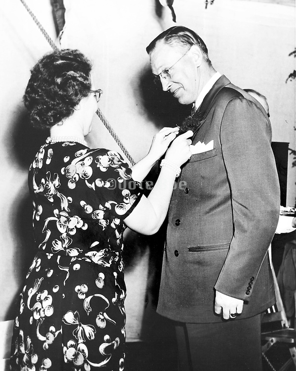 office worker receiving a decoration for his services during the last year, USA 1940s