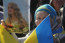 March 29, 2019 - Kiev, Ukraine - People hold national flags and portraits of Yulia Tymoshenko as they attend political rally in Kyiv,  Ukraine,  March 28, 2019. Presidential  candidate Yulia Tymoshenko holds her last pre-election rally in Kyiv. (Credit Image: © Sergii Kharchenko/NurPhoto via ZUMA Press)