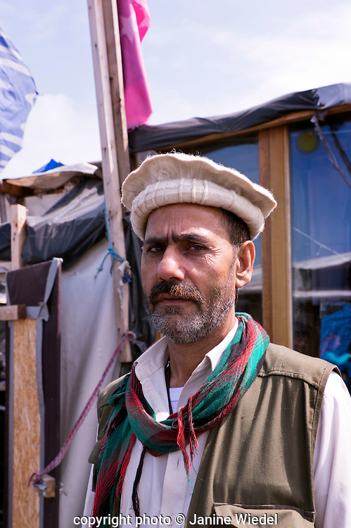 Portrait of man from Afghanistan at The Calais Jungle Refugee and Migrant Camp in France