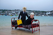 EDITORS NOTE: Image contains profanity. Ocean Rebellion staged the penultimate part in their sequence of theatrical protests at the British Government's links to the fossil fuel industry on the 9th June 2021 on Harbour beach, St Ives, Cornwall, United Kingdom. Featuring Boris Johnson in a romantic relationship with a Fossil Fuel oligarch. The pair appeared to consummate their relationship in bed on the beach in St Ives where the G7 summit will take place. The G7 summit held in Carbis Bay between June 11-13 and will see world leaders gather to discuss some of the most pressing challenges facing us, from climate change to tackling the ongoing Covid-19 pandemic.