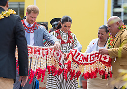The Duke and Duchess of Sussex are presented with ta'ovala during a visit to an exhibition of Tongan handicrafts at the Fa'onelua Convention Centre, in Nuku'Alofa, Tonga, on day two of the royal couple's visit to Tonga.