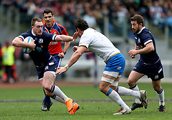 Scotland's Stuart Hogg (left) during the NatWest 6 Nations match at the Stadio Olimpico, Rome.
