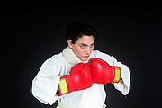 Aggressive female boxer with a whiplash collar On black Background