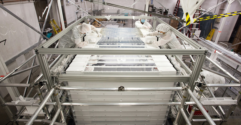 Photo by Mara Lavitt<br /> New Haven, CT<br /> November 17, 2017<br /> Photography: ©Mara Lavitt<br /> <br /> The final stages of building a neutrino detector at Yale University's Wright Lab. From left: Yale Postdoctoral Researcher Tom Langford, Temple University Research Engineer James Wilhelmi, <br /> Yale graduate student Danielle Norcini.