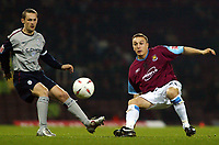 Photo. Chris Ratcliffe<br /> West Ham United v Crewe Alexandra. Coca Cola Championship. 15/03/2005<br /> Mark Noble of West Ham tussles with Crewe's Kenny Lunt