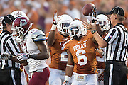 AUSTIN, TX - AUGUST 31: Quandre Diggs #6 of the University of Texas Longhorns celebrates after recovering a fumble against the New Mexico State Aggies on August 31, 2013 at Darrell K Royal-Texas Memorial Stadium in Austin, Texas.  (Photo by Cooper Neill/Getty Images) *** Local Caption *** Quandre Diggs