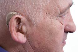 Man wearing a hearing aid,