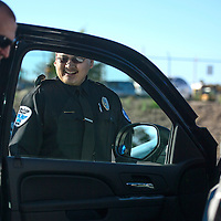 080614       Cayla Nimmo<br /> <br /> Officer Charles Steele smiles while his vehicle is begging inspected by Department Heads during the Gallup Police Department annual inspection Wednesday morning.
