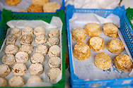 Goats soft whole cheese on a cheese market stall Honfleur Normandy France