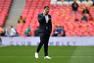 Troy Deeney (9) of Watford talking on his mobile phone while on the Wembley pitch before the The FA Cup Final match between Manchester City and Watford at Wembley Stadium, London, England on 18 May 2019.