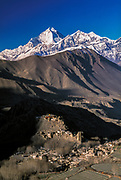 Jharkot Dzong and village near Muktinath in winter with Dhaulagiri I (8167m) behind, Kali Gandaki valley, near entrance to Mustang, Nepal.