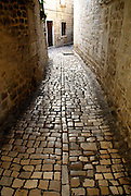 Stone paved alley and walls, Trogir, Croatia