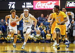 Nov 24, 2018; Morgantown, WV, USA; West Virginia Mountaineers guard Chase Harler (14) steals the ball during the second half against the Valparaiso Crusaders at WVU Coliseum. Mandatory Credit: Ben Queen-USA TODAY Sports