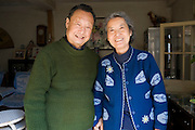 Chinese couple, Mr and Mrs Wu, in their traditional home in the Hutongs area, Beijing, China