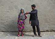 """AFGHANISTAN WITHOUT TALIBANS<br /> <br /> There is a region in Afghanistan where the Talibans have never really been able to impose their rule. Wedged between Tajikistan and Pakistan, the Afghan Pamir is an area of precarious peace.<br /> Promoted by the Afghan government to try and attract tourists in search of adventure, it is also the gateway to the Wakhan Corridor that Marco Polo used in the 13th century and it is where the legendary nomads have lived isolated from the rest of the world at an altitude of 4,500 meters, with the only company of their yaks.<br /> <br /> For safety reasons, the border can only be crossed from Tajikistan. The Panj river separates the two states. It is 2pm and loud honking is necessary to draw the attention of the Afghan border guards busy playing volleyball.<br /> In the entrance of the border post, there is a portrait of Salah Abdeslam, the terrorist involved in the Paris attacks on 13 November 2015. The border guard mimes cuffed hands to convey to me that he was captured. Next to him, a poster displays all the presidents of Afghanistan. I recognize the current one, Ashraf Ghani, as well as his predecessor, Hamid Karzai, and on a blurry black and white picture reminiscent of a «Wanteddead or alive» poster, Mullah Omar!<br /> <br /> My passport is scanned and then mailed to Kabul to be checked against the database. """"Security,"""" the border guard tells me. But the Internet connection is down. """"We'll check on your way back,"""" he says, annoyed, before handing me my visa number 339.<br /> <br /> A few kilometers and potholes later, I arrive in Ishkashim, the largest village in the region, which boils down to two dusty roads lined with stalls. A Toyota pickup truck full of armed soldiers patrols at high speed. I see my first pakols, the famous hat immortalized by General Massoud, and surprise, women walking while all wearing blue burqas.<br /> The population of Pamir is predominantly Ismaili, a branch of Shia Islam that follows the precepts """