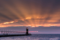 The clouds eclipsed the sun better than the moon did on this evening in South Haven.  Although the eclipsed sun was not visible due to the clouds, the sunset was spectacular nonetheless.