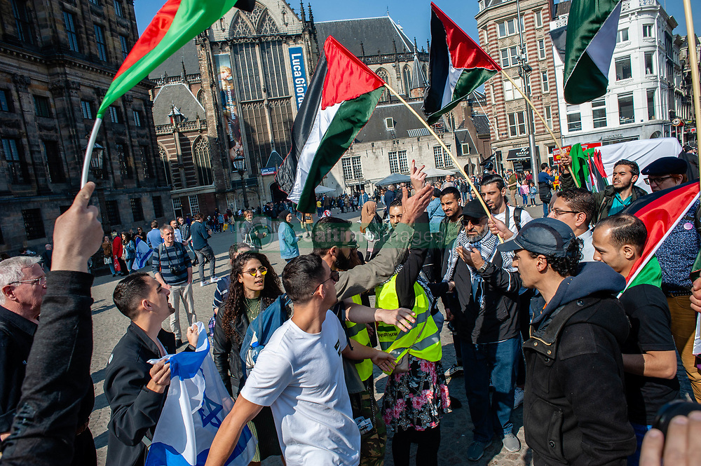 March 30, 2019 - Amsterdam, North Holland, Netherlands - March 30th, Amsterdam. Palestinians rebelled massively on March 30, 1976. The reason was the announcement by the State of Israel to expropriate large pieces of Palestinian land in Al-Jalil. Since then, 42 years have been commemorating the Day of the Land by all Palestinians wherever they are. In Amsterdam, a hundred of people gathered in solidarity with Palestinie. During the demonstration some people from the Israel side showed up creating a lot of tension. At some point, there was some fight between the two sides. Dutch police intervened to calm the situation. (Credit Image: © Romy Arroyo Fernandez/NurPhoto via ZUMA Press)