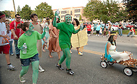 """Coming from the desert the """"seniors were too hot to handle"""" with Emily Dionne as Cleopatra and cacti Briana Ryan and Angelica Platon leading their senior class out from LHS for the annual Homecoming Parade Friday afternoon.  (Karen Bobotas/for the Laconia Daily Sun)"""