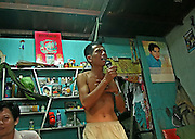 Vietnam, Mekong Delta, Can Tho: singing karaoke in a house.