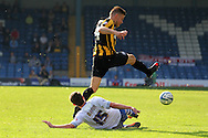 Bury's Danny Mayor tackles Southend's defender Marc Laird .. Skybet football league two match, Bury v Southend Utd at Gigg Lane in Bury, England on Sat 21st Sept 2013. pic by David Richards/Andrew Orchard sports photography