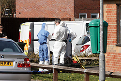 """© Licensed to London News Pictures.  29/03/2012. AYLESBURY, UK. Forensic officers continue to  investigate the scene of a shooting yesterday (Wed)  in Stour Close in the Walton Court area of Aylesbury, Buckinghamshire. The attack is thought to be not random. At a press conference today Thames Valley Police said they had """"no information"""" about rumours of a shootout between the gunman and the victim. They also refused to explain why the victim was taken away in handcuffs despite being seriously injured. Photo credit:  Cliff Hide/LNP"""