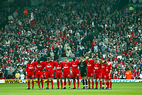 Liverpool's players and fans stand to observe a moments slience in memory of the 96 victims of the Hillsborough disaster in 1989 before the Premiership match against Fulham at Anfield, Liverpool, Saturday, April 12th, 2003.<br /> <br /> Pic by David Rawcliffe/Digitalsport