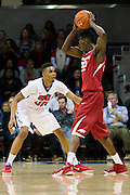 DALLAS, TX - NOVEMBER 25: Ben Moore #00 of the SMU Mustangs defends against the Arkansas Razorbacks on November 25, 2014 at Moody Coliseum in Dallas, Texas.  (Photo by Cooper Neill/Getty Images) *** Local Caption *** Ben Moore