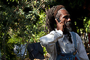 Rastafarian man 'Ras Cover' on the phone, St Thomas, Jamaica.