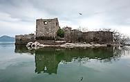 Ruined fortress on Grmozur island, later used as a prison. Lake Skadar (Skadarsko jezero) National Park, Montenegro © Rudolf Abraham