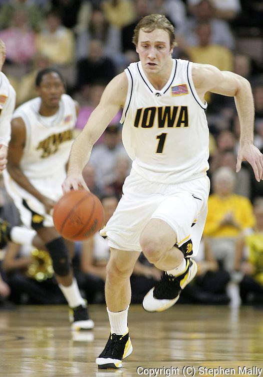 15 FEBRUARY 2007: Iowa guard Adam Haluska (1) drives down court in Iowa's 66-58 win over Northwestern at Carver-Hawkeye Arena in Iowa City, Iowa on February 15, 2007.