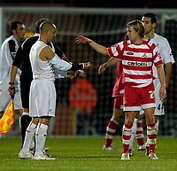 Photo: Jed Wee/Sportsbeat Images.<br />Doncaster Rovers v Bolton Wanderers. The FA Cup. 06/01/2007.<br /><br />Bolton's Stelios Giannakopoulos (L) sportingly offers his shirt to Doncaster's James Coppinger.