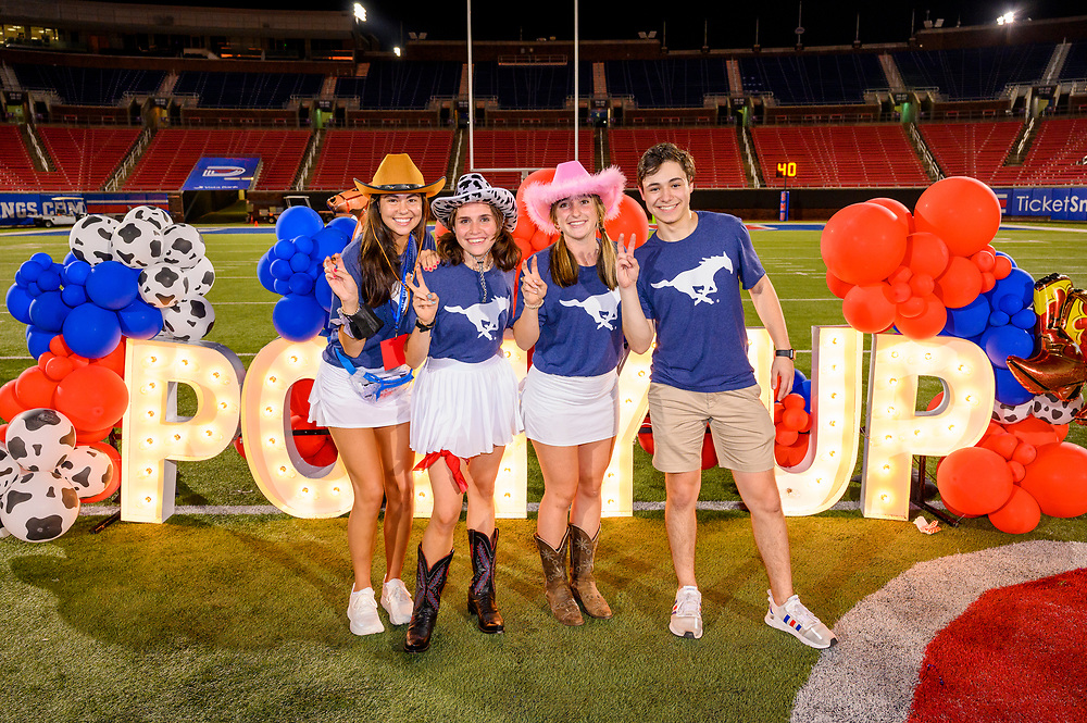 First year students attend Stampede Sundown, Friday, August 20, 2021 at the Gerald J. Ford Stadium on the SMU Campus. Activities included games, photo booths, petting zoo and state fair food.
