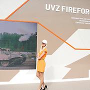 Tanks, guns and girls at the IDEX arms fair