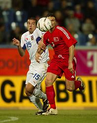 TEPLICE, CZECH REPUBLIC - Wednesday, April 30, 2003: Czech Republic's Milan Baros and Turkey's Alpay Ozalanal during a friendly match at the Teplice Stadion Na Stinadlech. (Pic by David Rawcliffe/Propaganda)