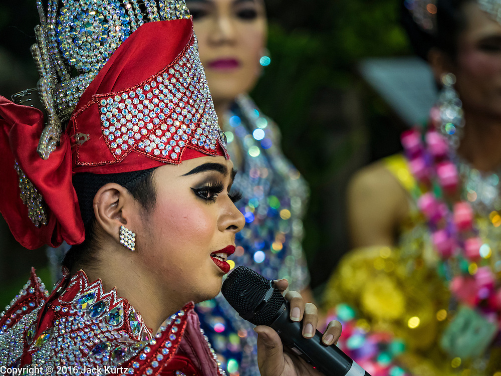25 SEPTEMBER 2016 - BANGKOK, THAILAND:  Likay performers on stage during a Likay performance in Pom Mahakan Fort. The performance was to support residents of the old fort, who are fighting eviction orders by the city of Bangkok. City officials have made repeated attempts to evict people since Sept 3, 2016, but about 44 families are still living in the community. Likay is a form of popular folk theatre from Thailand. It uses a combination of extravagant costumes, barely equipped stages and vague storylines. The performances depend mainly on the actors' skills of improvisation and the audiences' imagination. There used to be several Likay troupes based in the old fort, but they left the community more than 50 years ago. The troupe that performed Sunday night was an amateur troupe comprised of college students and office workers.     PHOTO BY JACK KURTZ