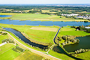 Nederland, Gelderland, 30-09-2015; Neder-rijn, uiterwaardvergraving De Tollewaard. In de uiterwaard is een nevengeul gegraven. De steenfabriek is bij hoog water bereikbaar door middel van de brug. Omdat de brug op kolommen staat kan het hoog water ongehinderd stromen<br /> Lower Rihine, in the the floodplain  a secondary - high waters - channel has been excavated.<br /> luchtfoto (toeslag op standard tarieven);<br /> aerial photo (additional fee required);<br /> copyright foto/photo Siebe Swart