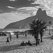 Beach life. Walking on the beaches of Rio de Janeiro around Ipanema and Leblon. A wonderful mix of lives and passions from all parts of society - and a lot of beach volleyball. Here the Mirante do Morro Dois Irmãos hills behind Leblon and Vidigal are immediately recognisable.