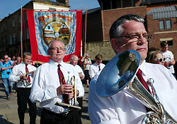 "© Licensed to London News Pictures. 13/07/2013<br /> <br /> Durham City, England, United Kingdom<br /> <br /> A colliery band marches through the centre of Durham.<br /> <br /> The Durham Miners' Gala is a large annual gathering held each year in the city of Durham. It is associated with the coal mining heritage of the Durham Coalfield, which stretched throughout the traditional County of Durham, and also gives voice to miners' trade unionism. <br /> <br /> Locally called ""The Big Meeting"" or ""Durham Big Meeting"" it consists of banners, each typically accompanied by a brass band, which are marched to the old Racecourse, where political speeches are delivered. In the afternoon a Miners' service is held in Durham Cathedral <br /> <br /> Photo credit : Ian Forsyth/LNP"