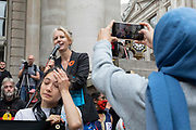 Extinction Rebellion activist at the Bank of England records a video of one of Dr Gail Bradbrook, co-founder of Extinction Rebellion on her iPhone as the speaker gives a speech on the steps of the Bank of England on 27th August, 2021 in London, United Kingdom. The activist group Extinction Rebellion XR are planning actions of disruption for two weeks straight beginning on August 23rd, 2021 in an effort to bring awareness and priority to the global climate emergency in advance of the COP 26 Summit which will be held in Glasgow later this year.