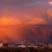 Storm clouds hang over downtown as the sun sets in Albuquerque, New Mexico. Nathan Lambrecht/Journal Communications