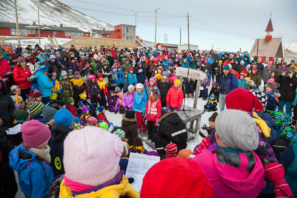 Children lead the singing of a song in honor of the sun at SolFest in Longyearbyen, Svalbard. The festival marks the official arrival of the sun to the town – by tradition, to the old hospital steps (sykehustrappa).