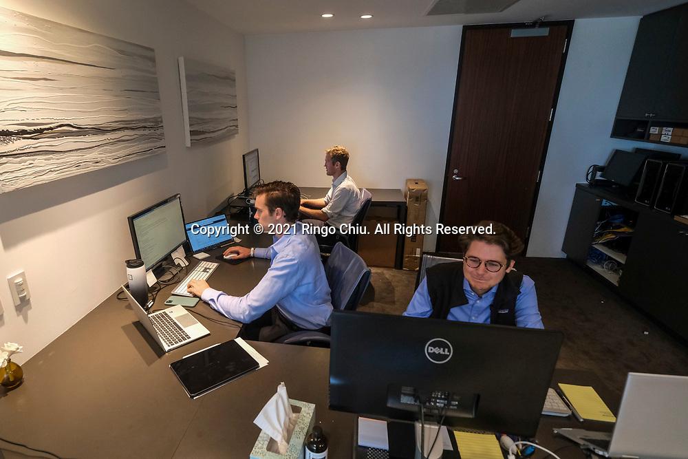 Staff of Diversis Capital Management. (Photo by Ringo Chiu)