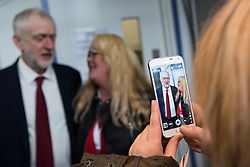 © Licensed to London News Pictures. 20/02/2016. Llandudno UK. Picture shows Labour leader Jeremy Corbyn posing for photographs with a woman after he delivered his keynote address at the Welsh Labour Party Conference 2016 in Llandudno, Wales. Photo credit: Andrew McCaren/LNP