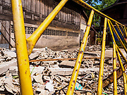 20 MARCH 2017 - BANGKOK, THAILAND: A barricade in front of an empty lot that used to be a home in Pom Mahakan. As families are evicted the government immediately tears down the home so squatters don't move into it. The final evictions of the remaining families in Pom Mahakan, a slum community in a 19th century fort in Bangkok, have started. City officials are moving the residents out of the fort. NGOs and historic preservation organizations protested the city's action but city officials did not relent and started evicting the remaining families in early March.               PHOTO BY JACK KURTZ